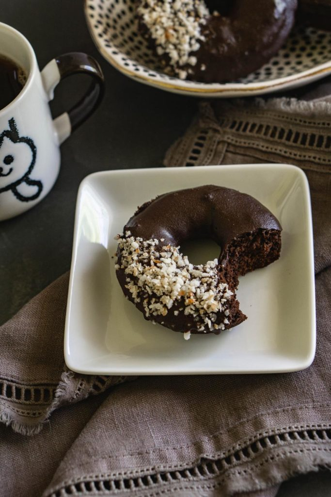 Paleo chocolate donut with coconut flakes