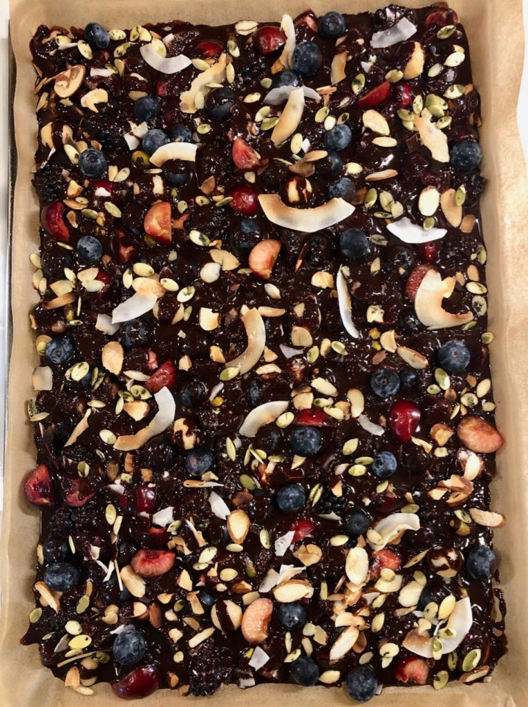 Paleo dark chocolate fruit & nut bark after drizzling chocolate